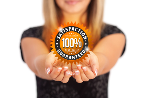 Hamilton Flooring employee with Satisfaction Guaranteed symbol